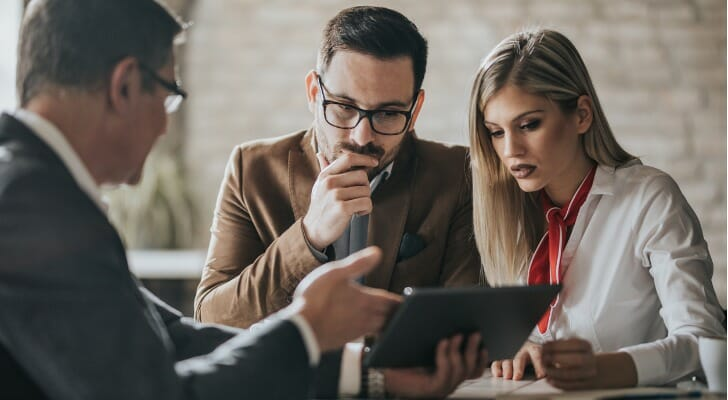 Young couple consults with a financial advisor about trusts