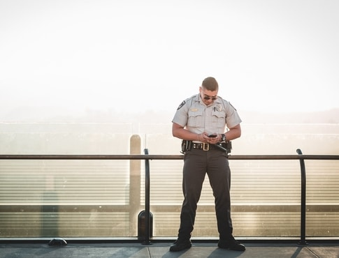 Patrol officer leaning on a railing